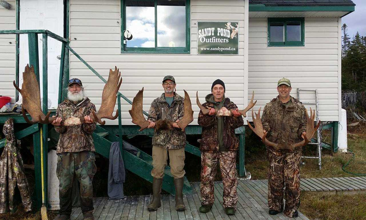 Guys in front of Sandy Pond Cabin